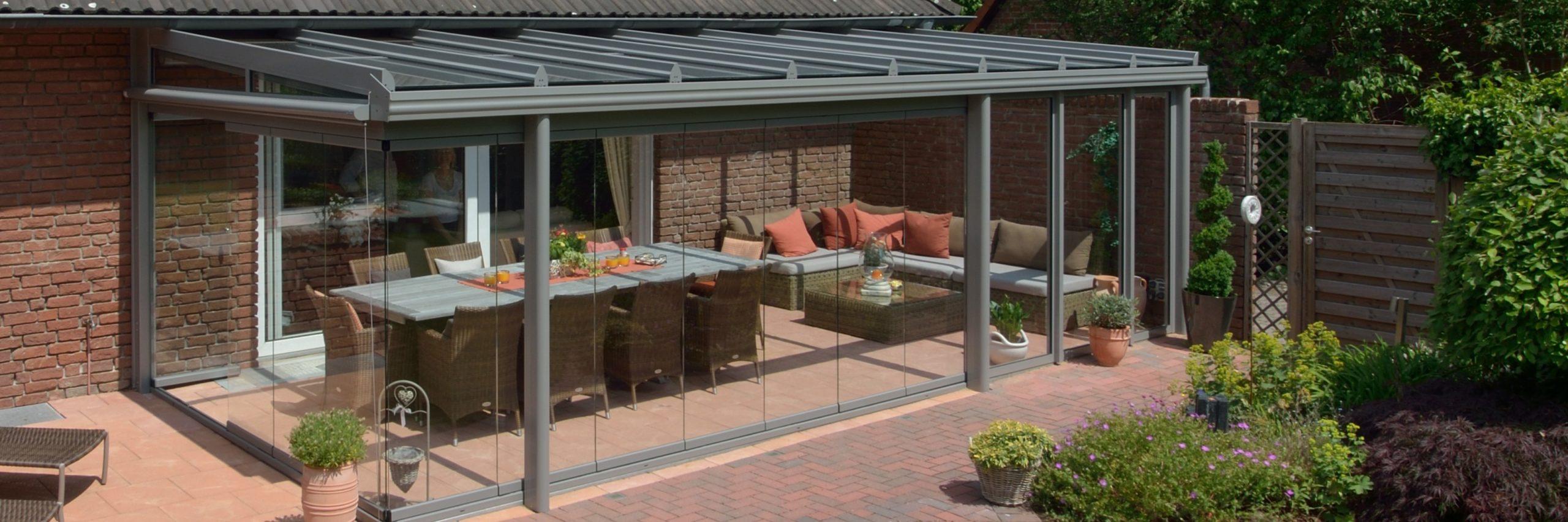 Terrassendach als Glasoase mit Glasschiebeelementen